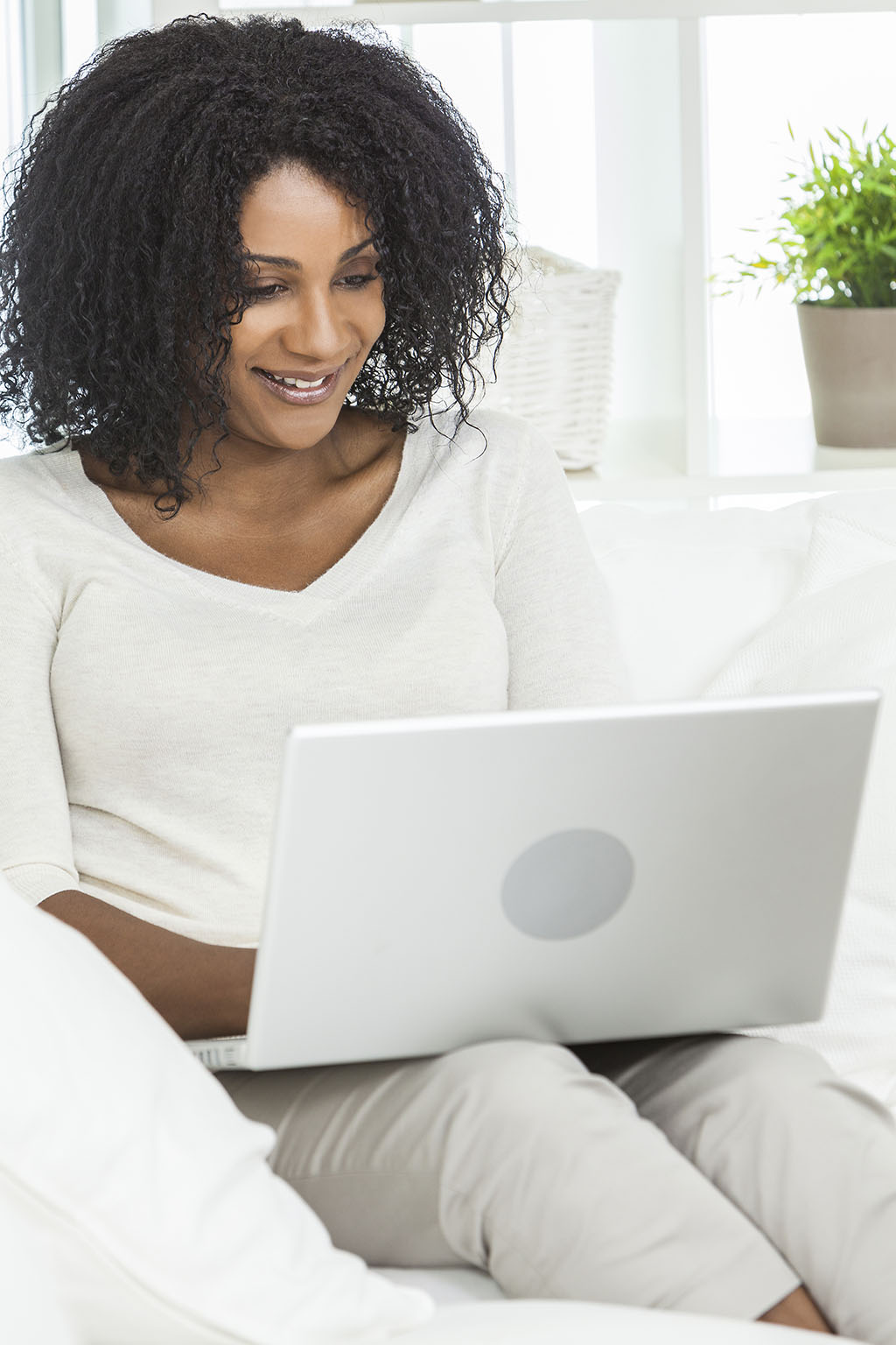 Image of a woman using a laptop