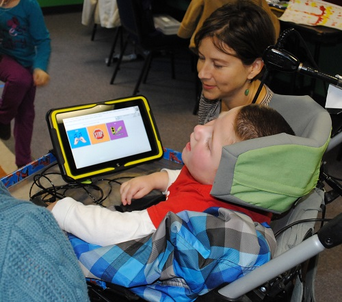 photo of a PRC consultant with a young child using CoreScanner